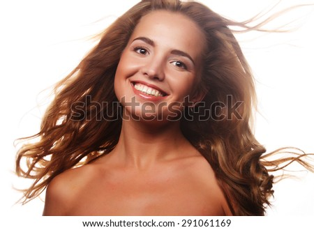 young beautiful woman with curly hair isolated on white - stock photo