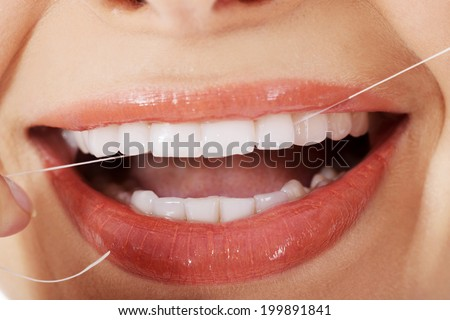 Young beautiful woman with dental floss. - stock photo