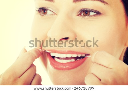 Young beautiful woman with dental floss.
