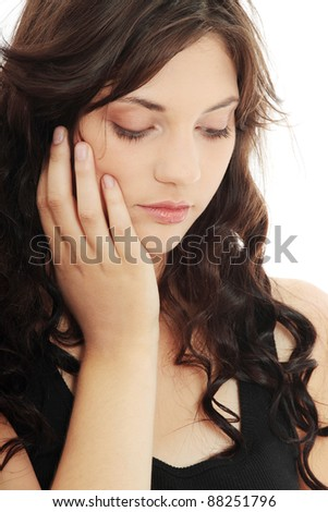 Young beautiful woman with depression isolated on white - stock photo