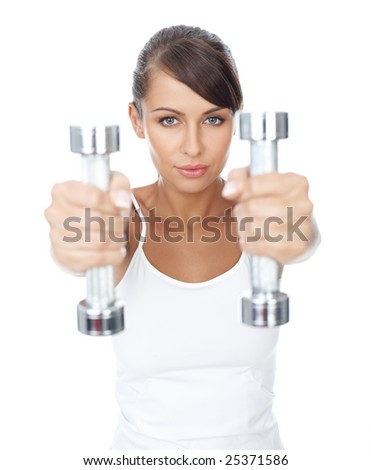 Young beautiful woman with dumb-bells in hands - stock photo