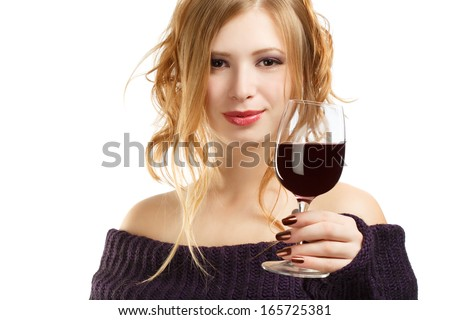 Young beautiful woman with expressive hairstyle and glass of red wine isolated on white background - stock photo