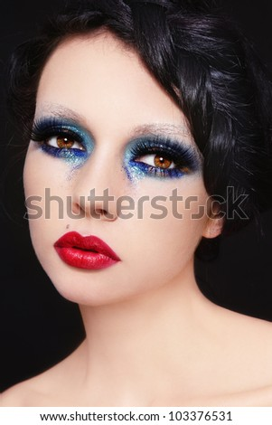 Young beautiful woman with fancy retro make-up and hairstyle - stock photo