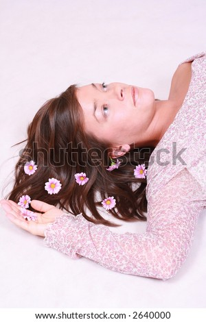 young beautiful woman with flowers in her hair - stock photo