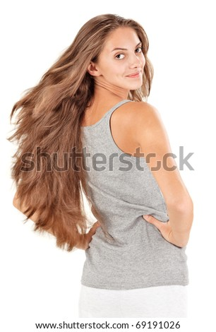 Young beautiful woman with flying long hairs on white