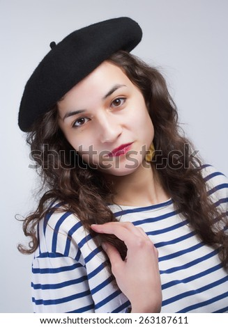 Young Beautiful Woman with French Style Beret and Striped T-Shirt - stock photo