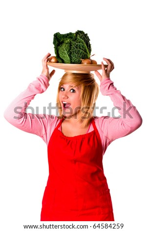 young beautiful woman with fresh savoy cabbage and onions on her head isolated - stock photo