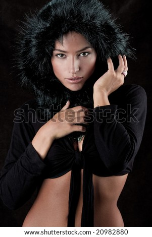 young beautiful woman with fur hood - stock photo