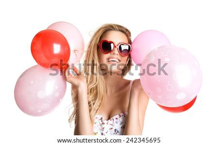 Young beautiful woman with glasses holding red pink balloons, valentine's day, isolated