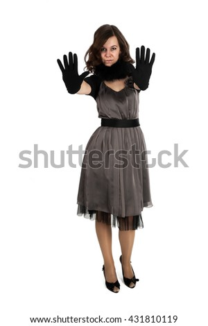 Young beautiful woman with gloves showing stop gesture - stock photo