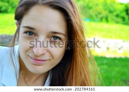 Young beautiful woman with green eyes and long hair smiling
