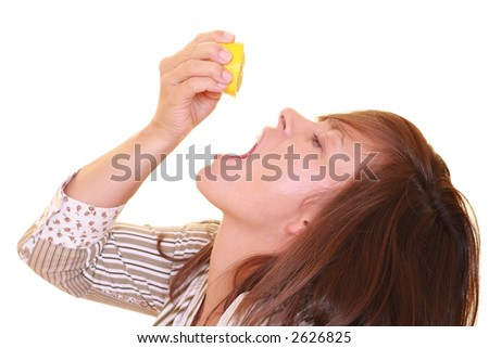 young beautiful woman with half of lemon isolated on white - vitamins - stock photo