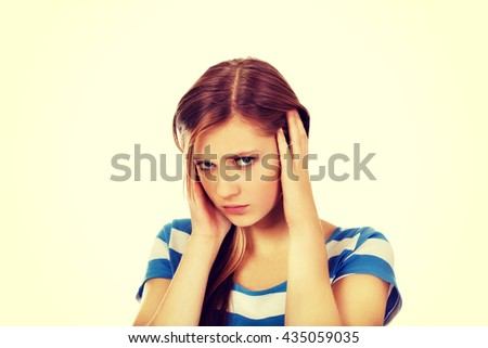 Young beautiful woman with headache - stock photo