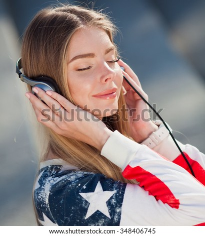 Young beautiful woman with headphones - stock photo