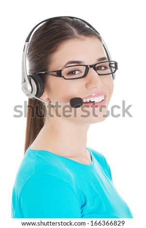 Young beautiful woman with headphones and microphone. Isolated on white.  - stock photo