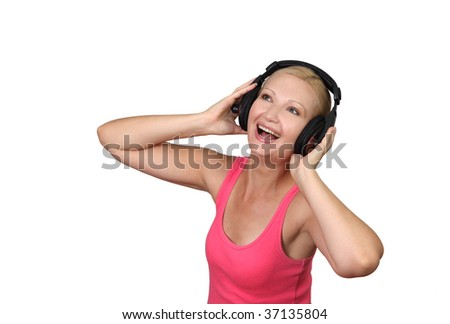 Young beautiful woman with headphones listening music isolated on white - stock photo