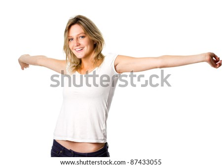 Young beautiful woman with her arms outstretched - freedom pose