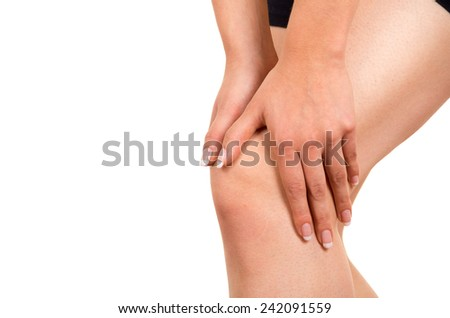 young beautiful woman with knee pain isolated on white