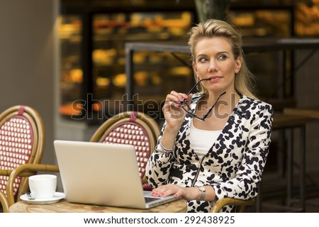 Young beautiful woman with laptop outdoors.  - stock photo
