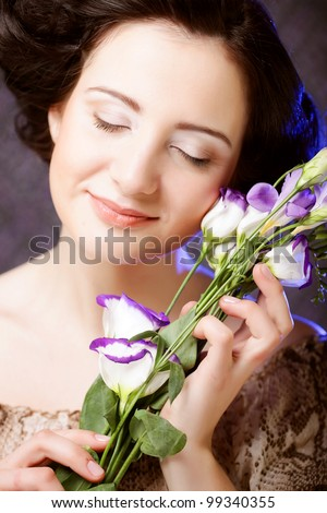 young beautiful woman with lilac  flower - stock photo