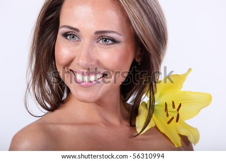 young beautiful woman with Lily flower - stock photo