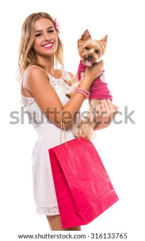 Young beautiful woman with little dog yorkshire terrier and shopping bags isolated on white background. - stock photo