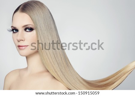 Young beautiful woman with long blond hair and stylish make-up - stock photo