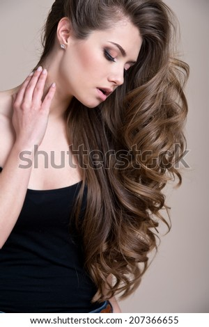 young beautiful woman with long curly hair - stock photo