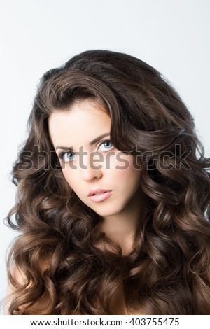 Young beautiful woman with long curly hair.