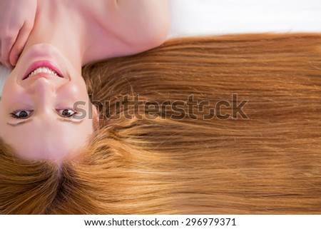 Young beautiful woman with long hair on white background - stock photo