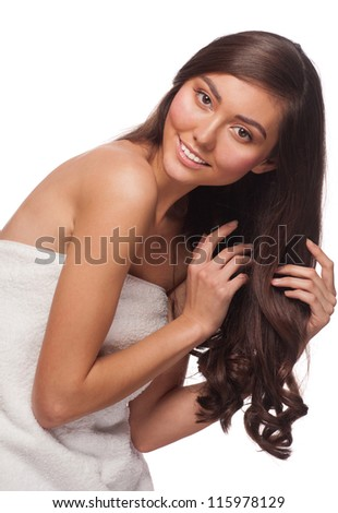 Young beautiful woman with long healthy curly hair. Isolated on white background - stock photo