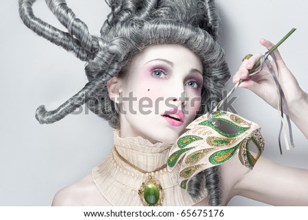 young beautiful woman with masquerade mask - stock photo