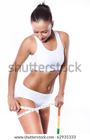 Young beautiful woman with measure tape on white - stock photo