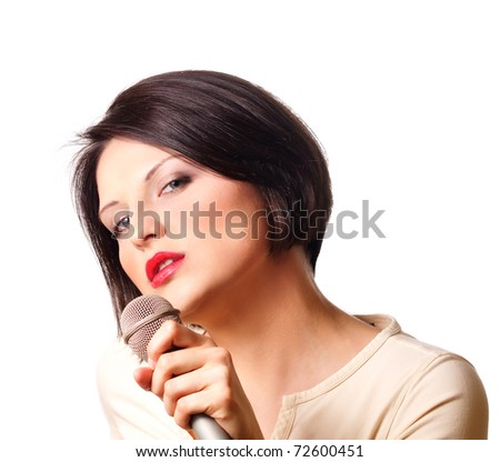 Young beautiful woman with microphone - stock photo