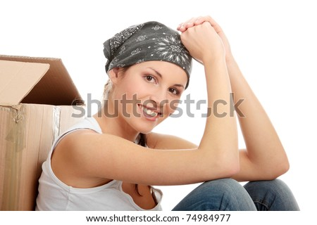 Young beautiful woman with packages for house moving (isolated on white) - stock photo