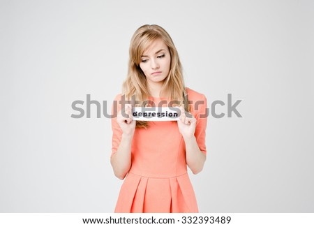 Young beautiful woman with paper blank of word Depression, sad and depressed, deep in thoughts on white background - stock photo