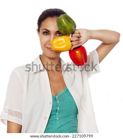 Young beautiful woman with pepers - stock photo