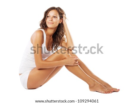 Young beautiful woman with perfect body in white underwear - stock photo