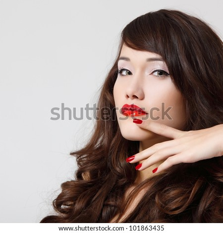 young beautiful woman with perfect long hair and vivid red lipstick