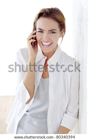 young beautiful woman with phone - stock photo