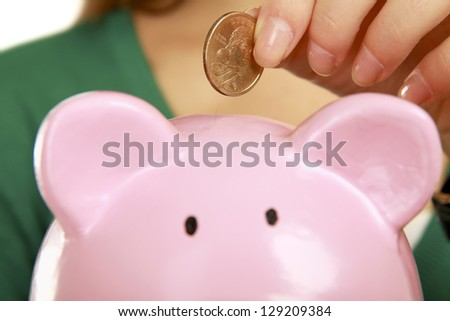 Young beautiful woman  with piggy bank (money box), isolated on white background