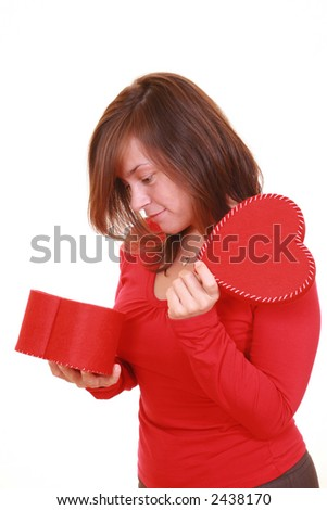 young beautiful woman with red heart isolated on white - stock photo