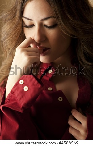 Young beautiful woman with sensual gesture wearing male skirt