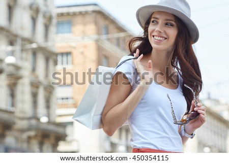 Young beautiful woman with shopping bags in the ctiy- Let's go shopping concept - stock photo
