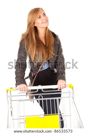 young beautiful woman with shopping cart, white background - stock photo