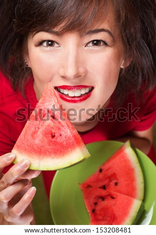 Young beautiful woman with slice of watermelon, top view - stock photo