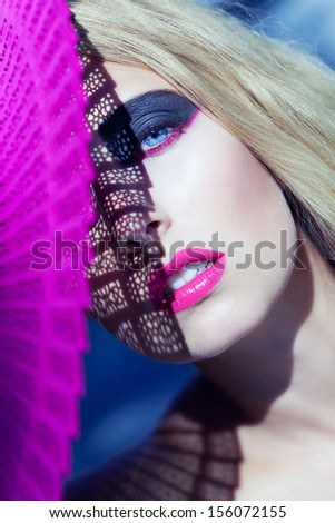 young beautiful woman with smokey eyes and pink lips portrait makeup