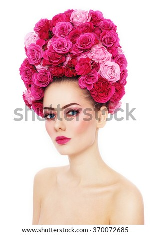 Young beautiful woman with stylish make-up in fancy vintage style wig of pink roses over white background - stock photo