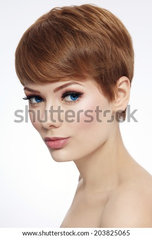 Young beautiful woman with stylish short haircut and fresh make-up - stock photo