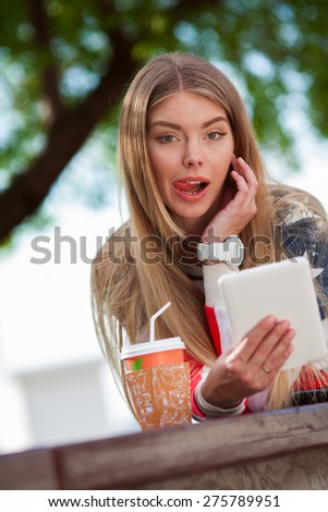 Young beautiful woman with tablet